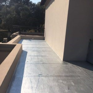 Careful inspection and repair to the existing waterproofing layer by trained workmen. The completed repair and overcoating job which will substantially extend the life of the waterproofing system.